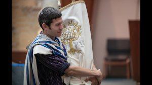 Rabbi Joshua Jacobs-Velde carry Torah at Shabbat