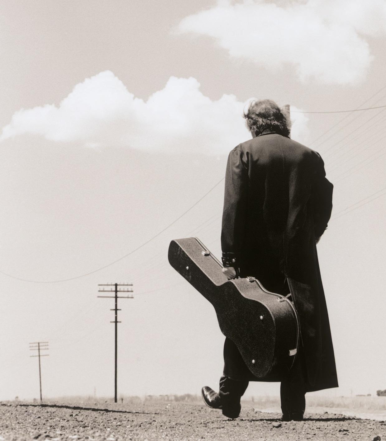 guitar player walking away